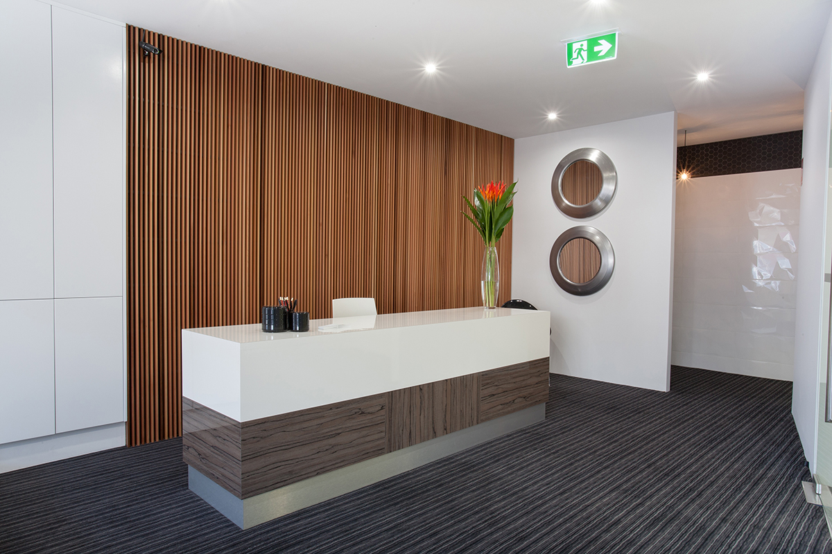 Dental practice reception desk joinery finished in polyurethane with Corian benchtops